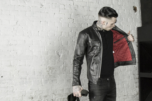 Leather Monkeys cafe racer leather jackets worn by a man with tattoos and beard